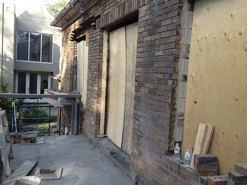 Windows and doors being bricked in at back of house
